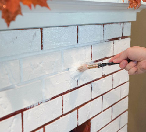 Painting fireplace mortar with angled brush