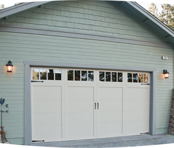 Green house with a white garage